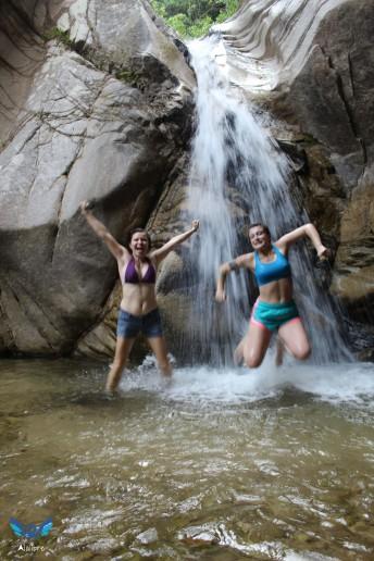 Carmen and Brooke jumping at the Waterfall